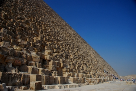 with high stone pyramid in egypt and blue sky