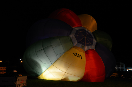 to inflate: colorful big balloons inflate at night Editorial