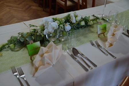 tables at a wedding with place setting and cards for bride and groom photo