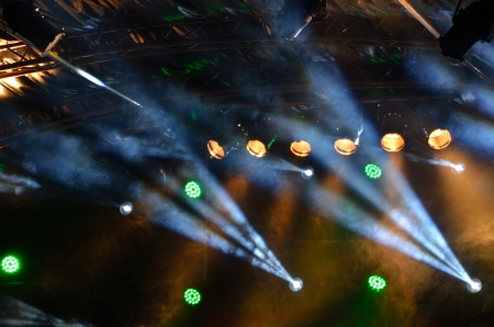 efficiently: many multicolored spotlights on a stage for concert Stock Photo