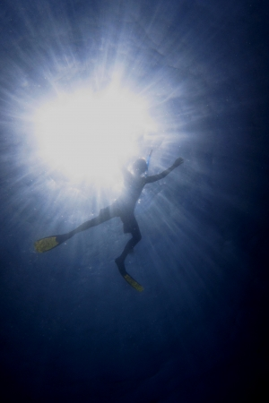 freediving: snorkelling in the blue sea with sun on vacation
