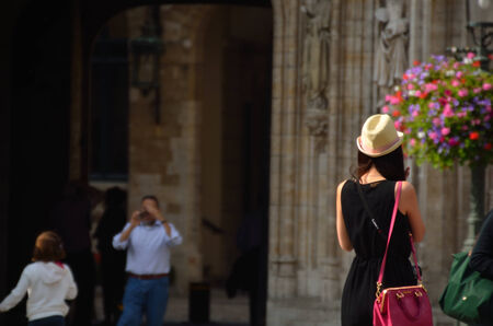 young woman with hat and bag is in the city Stock Photo