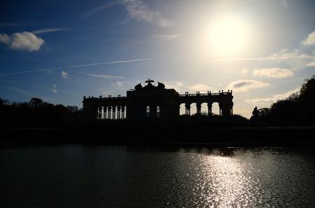 gloriette: gloriette of castle in vienna photographed against the sun