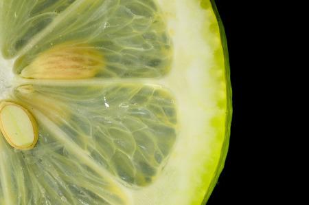 citrus family: fresh juicy yellow lemons on black background Stock Photo