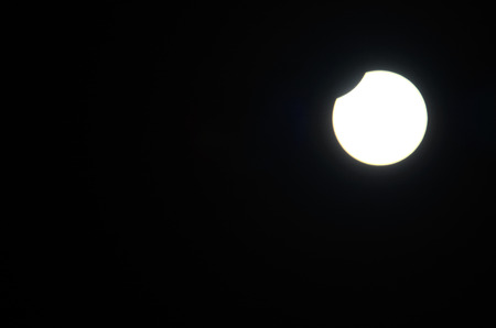 partial: very bright shining partial eclipse of the moon occurs Stock Photo