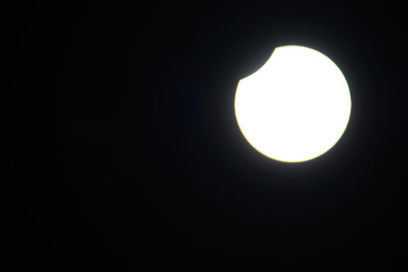 solar eclipse: very bright white solar eclipse