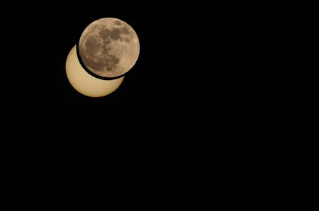 solar eclipse: beautiful partial solar eclipse moon with matching photomontage