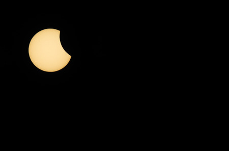 solar eclipse: solar eclipse with black sky view left Stock Photo