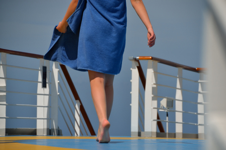maschine: young woman with blue towel on a cruise ship