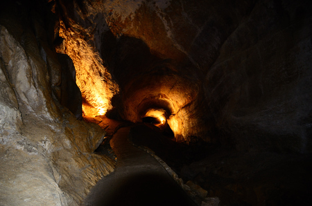 way through a dark cave in the mountains
