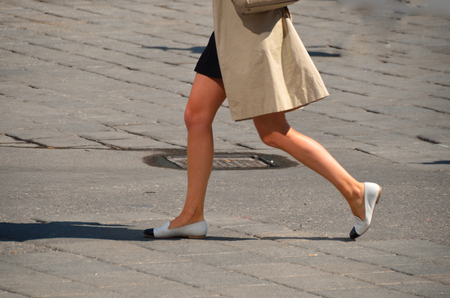 commercially: young woman with short skirt and jacket is very fast in the city Stock Photo