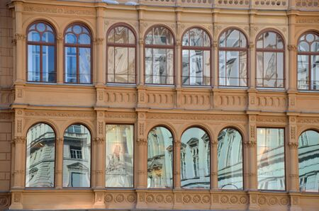 many windows: beautiful reflection in a facade with many windows