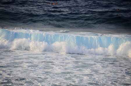 breaking wave: breaking wave with blue water at the beach