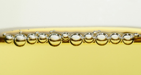 effervescence: many pearls of champagne in a glass closeup panorama