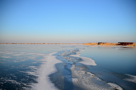 skids: long crack with snow in the frozen lake