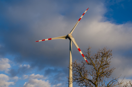 wind force: single pinwheel and clouds on the sky