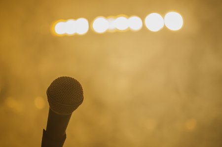 stage props: microphone on stage with bright headlights
