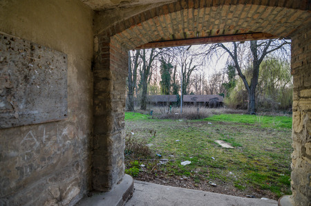 going places: old passage in an abandoned courtyard on a terrain