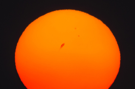 sunspot: orange large sun and large sunspot