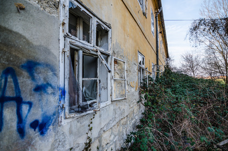 going places: dilapidated overgrown house from a factory