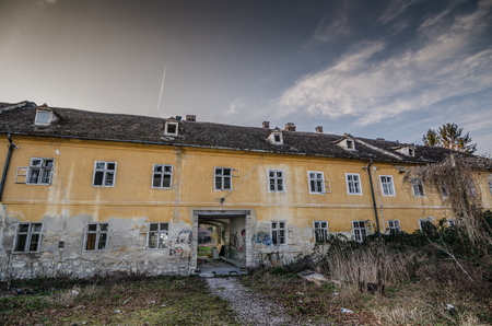 yellow house: old abandoned yellow house Stock Photo