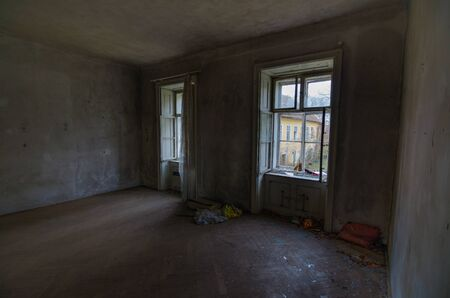 going places: old empty room with parquet floor