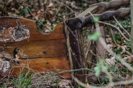 broken chair: old broken chair on the ground in the nature