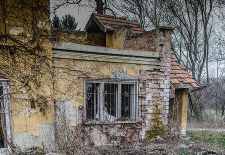 uninhabited: abandoned old house with brick