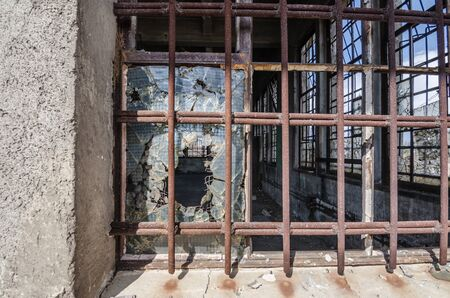 going places: window with thick iron bars Stock Photo