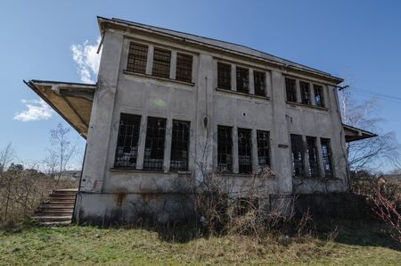 abandoned factory: high old abandoned factory building Stock Photo