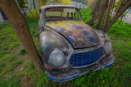 kilometres: old colorful classic car view above soft light Stock Photo