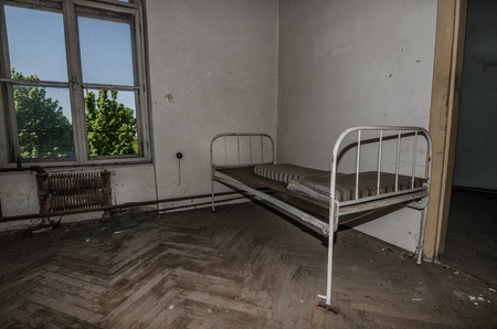 abandoned room: abandoned room with an old bed