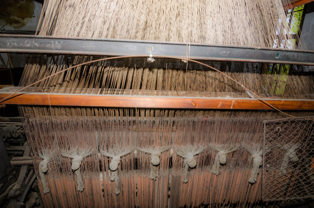 manufacturer: yarn in a loom in a cloth factory Stock Photo