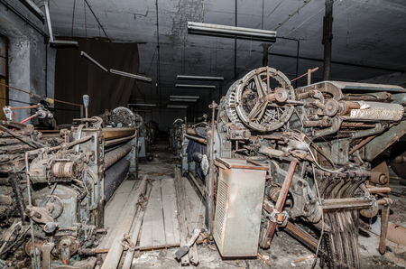 spinning factory: many old looms in a spinning factory Stock Photo