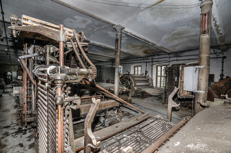 abandoned hall with machines in a factory