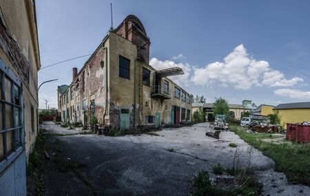 going places: old abandoned factory with tower panorama view