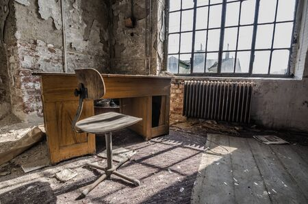 abandoned factory: office room in abandoned factory Stock Photo