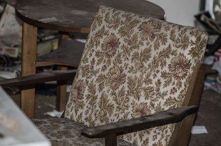 old chair with flowery fabric Stock Photo