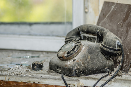 uninhabited: old black telephone in a building
