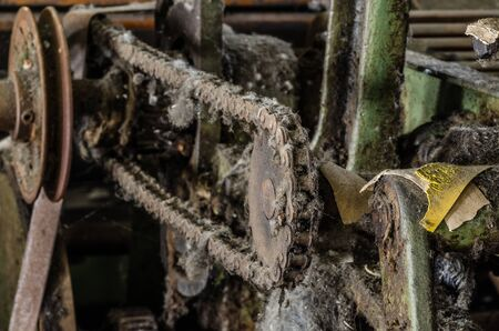 uninhabited: chain drive of old spinning machine in factory