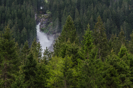 beautiful big waterfall with green forest Stock Photo