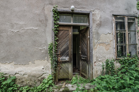 door of wood and old overgrown house
