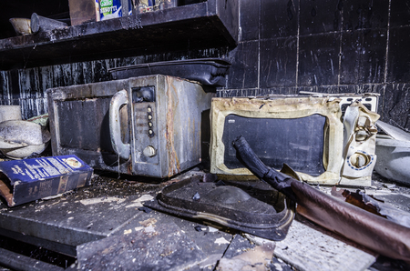 two microwave ovens after a kitchen fire