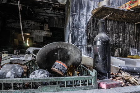 plate and bottle after a kitchen fire in house