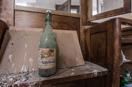 old bottle with juice in a house