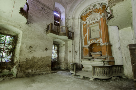 dilapidated church with altar interior view Stock Photo