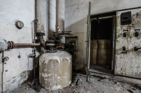 boiler with pipes in an old factory