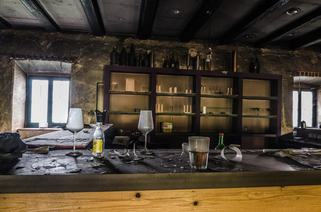 abandoned old bar with glasses