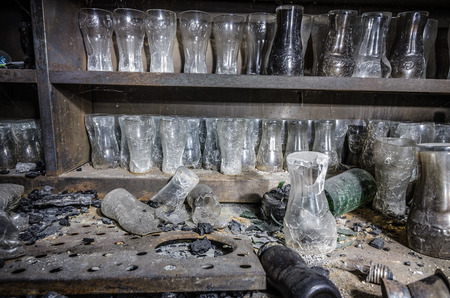 drinks glasses after big fire in a guest house Stock Photo