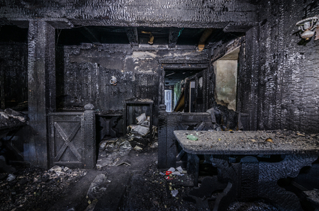 abandoned charred inn after big fire Stock Photo